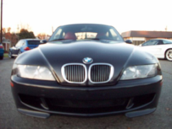 2000 BMW M Coupe in Cosmos Black Metallic over Kyalami Orange & Black Nappa - Front