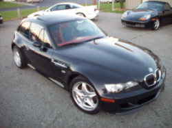 2000 BMW M Coupe in Cosmos Black Metallic over Kyalami Orange & Black Nappa - Front 3/4