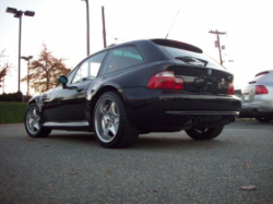 2000 BMW M Coupe in Cosmos Black Metallic over Kyalami Orange & Black Nappa - Rear 3/4