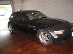 1999 BMW M Coupe in Cosmos Black Metallic over Dark Beige Oregon - Front 3/4